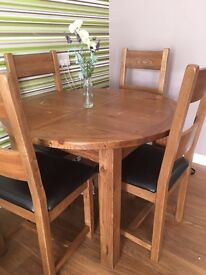 Solid wood extending table with four matching chairs