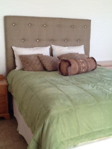 Upholstered  headboard with solid oak armour and bed stand