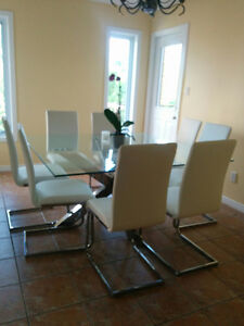 Beautiful modern dining table with chairs - 8 seats
