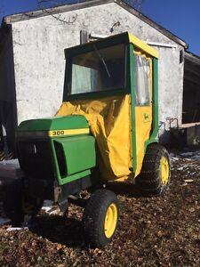John Deere 300 tractor with snowblower