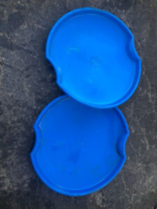 A pair of plastic disc sleds.   Welland.