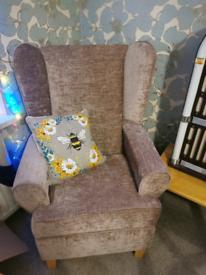 Mocha coloured armchair very comfy