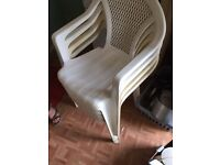 4 white plastic garden chairs
