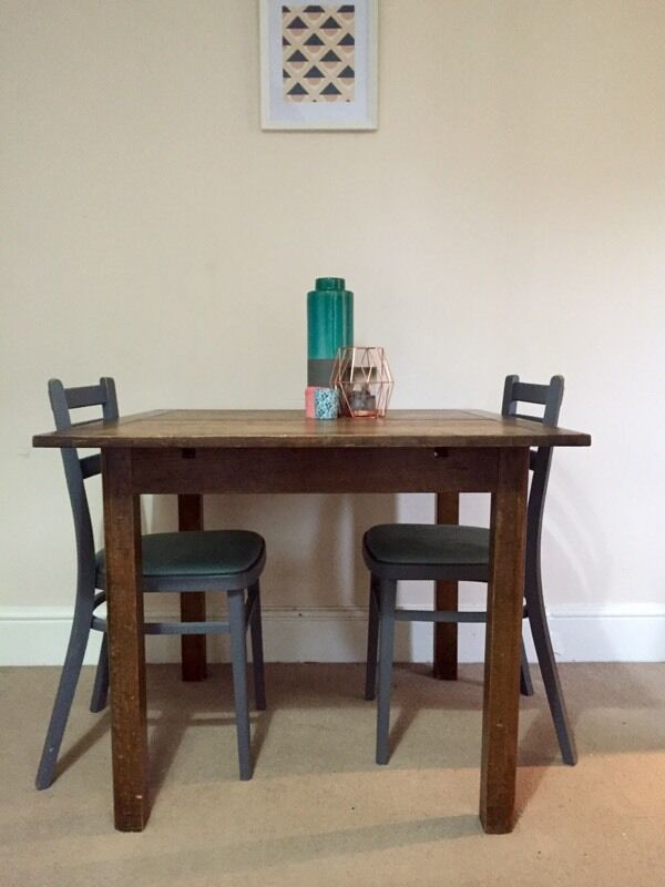 Small square dark wooden dining room table