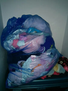 large blue bag filled with shoes for 0-6 months girl