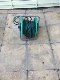 Garden hose on a wind up reel.