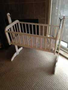 Beautiful antique swinging baby bassinet