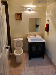 Private basement rooms with shared main floor.