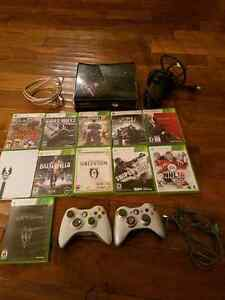 Xbox 360s 250GB with 4 controllers and 31 games
