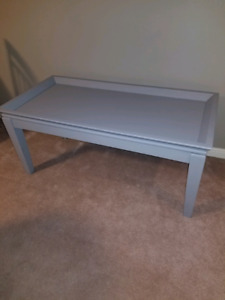 Grey coffee table. Sturdy. Use as is or add your creatively.