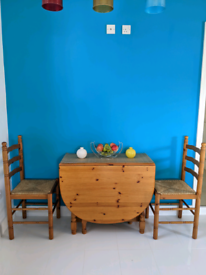 Solid pine dining table with 4 chairs
