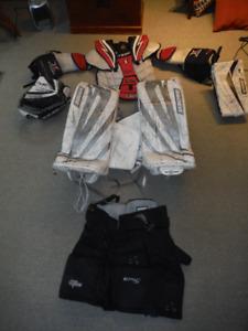 Goalie: pants, pads, glove RH, blocker, chest pad