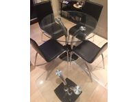 Glass table and side table plus 4 chairs for sale