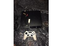 Playstation3 console with leads and wireless controller