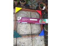 Plum wooden sandpit, new, with groundsheet and cover, £20 ono