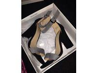 Size 6 black and grey heels unworn still in box