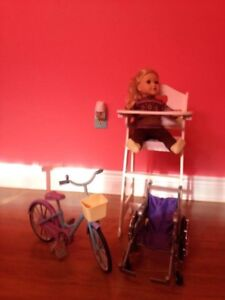 Child's toy high chair, doll bike and doll wheel chair
