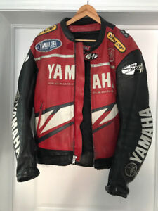 Men's leather Yamaha motorcycle jacket with matching gloves.