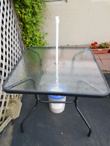Selling  glass table top patio table 4 chairs  and umbrella.