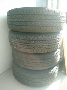 Set of 4 185/60R15 all season tires with steel rims