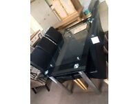 Glass table £80 chairs £45 each new