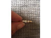 Gold diamond trilogy ring size O