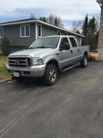 2006 Ford F-350 with Fisher V Plow