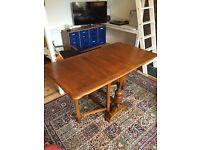 Folding drop leaf dining room table