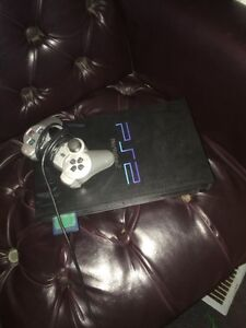 Ps2 with  controller and comes with 18 games