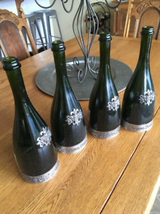 6 Champagne bottles with pewter adornments