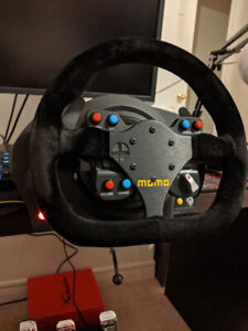 Thrustmaster setup, including wheel rim, base and pedals