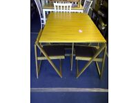 New folding butterfly table with 4 chairs.