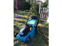 Electric lawn mower with collection box hardly used