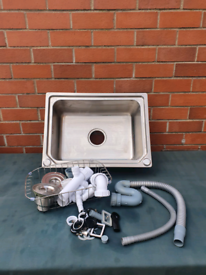 Stainless steel sink and various plumbing bits