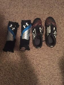 Lightly used soccer cleats and shin pads