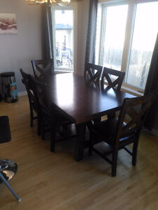 Dark brown table with 6 chairs