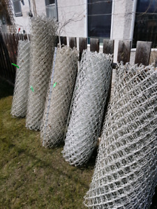 4 rolls of white coated chain link fence