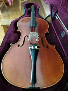 1/2 size cello.  Includes hard shell foam case and 2 bows.
