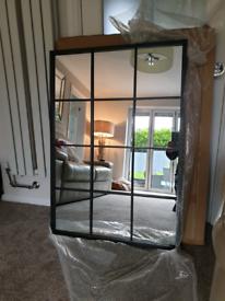 Beautiful black metal industrial window mirror