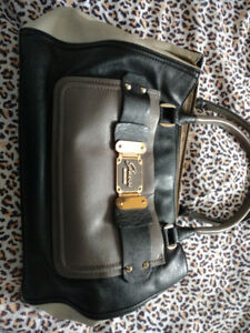 Guess purse asking 30.00 paid 150 new