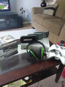 Xbox 360, 2 controllers & charger, headset,3 hard drives & 13 ga