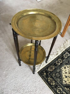 small table with brass round plates