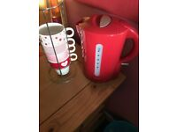 Red cordless kettle and stacking cups