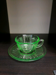 Depression glass tea cup and saucer