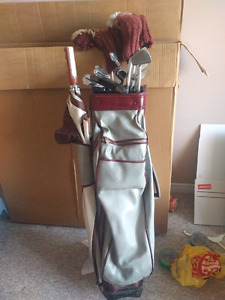 Complete set of Spalding golf clubs