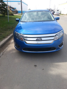 2012 Ford Fusion. With low Km rebuilt status
