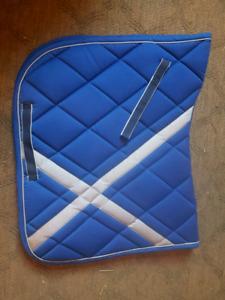 Brand new saddle pads and polos.