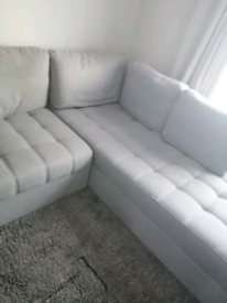 Corner sofa with fold out bed and 2 footstools grey/baige