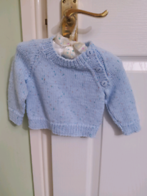New, hand knitted baby jersey