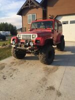 1994 Jeep YJ off roader trade for sea doo